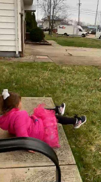 PHOTO: A 4-year-old named Ava Oliver jumped for joy as a fleet of FedEx trucks paraded through her Ohio neighborhood after her birthday party was canceled due to the novel coronavirus shutdown. (Ashley Sarago)