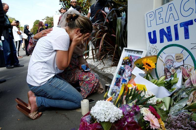 FILE PHOTO: A woman reacts at a make shift memorial outside the Al-Noor mosque in Christchurch