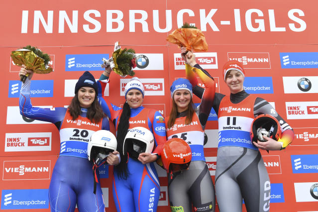 From left, second placed United State's Summer Britcher, Russia's first placed Tatyana Ivanova, third placed Germany's Julia Taubitz and Germany's Jessica Tiebel pose for media after the women's luge World Cup race in Igls, Austria, Saturday, Nov. 23, 2019. (AP Photo/Kerstin Joensson)