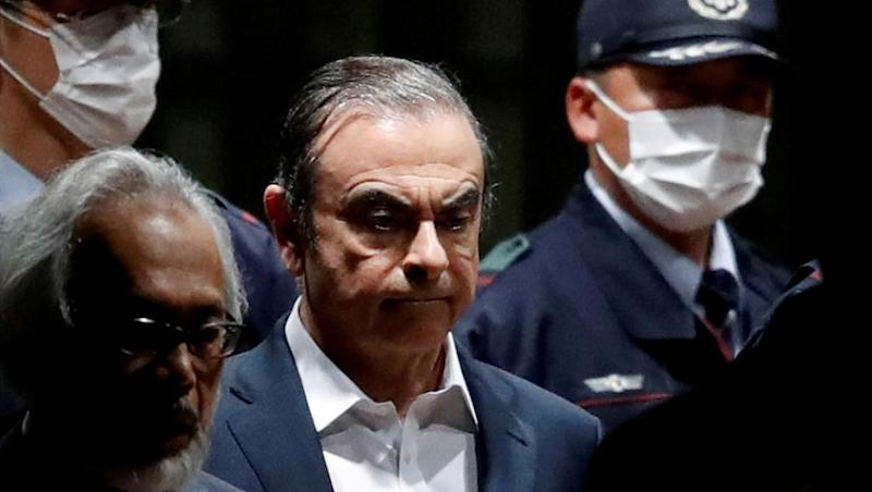 Ex-Nissan boss Ghosn fled Japan using spare French passport