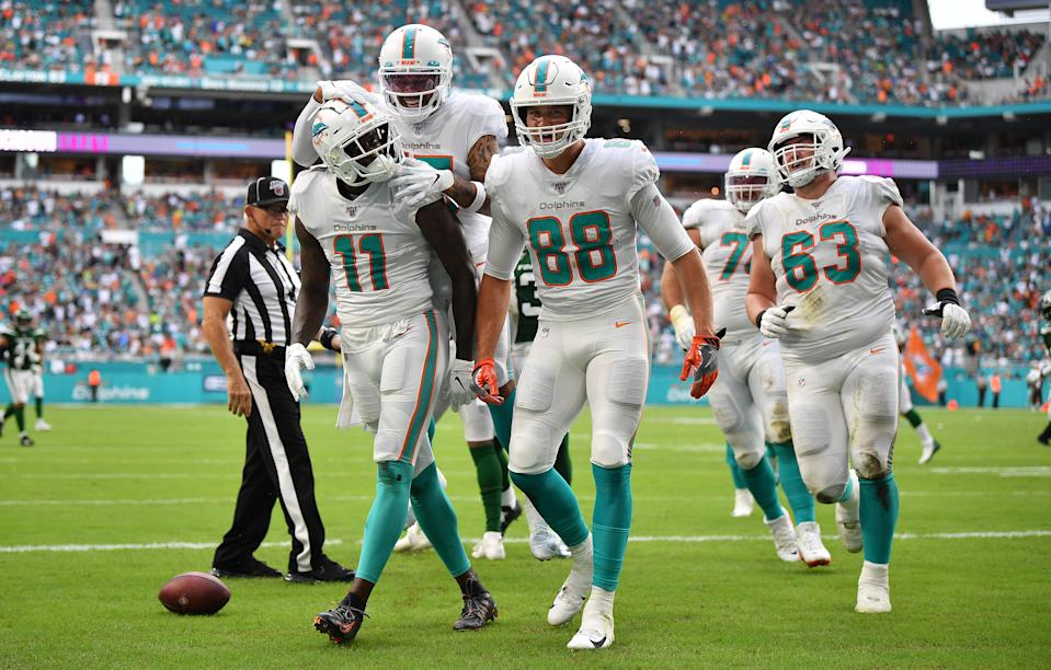 MIAMI, FLORIDA - NOVEMBER 03: DeVante Parker #11 of the Miami Dolphins celebrates catching a touchdown against the New York Jets in the second quarter at Hard Rock Stadium on November 03, 2019 in Miami, Florida. (Photo by Mark Brown/Getty Images)