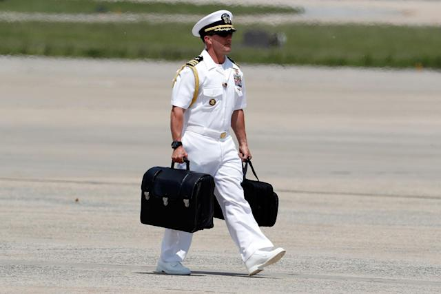 """<p>A U.S. Navy military aide carries the """"president's emergency satchel,"""" also know as """"the football,"""" with the nuclear launch codes, as he walks to Air Force One at Andrews Air Force Base, Md., Friday, May 19, 2017. President Donald Trump is departing for his first overseas trip. (Photo: Alex Brandon/AP) </p>"""