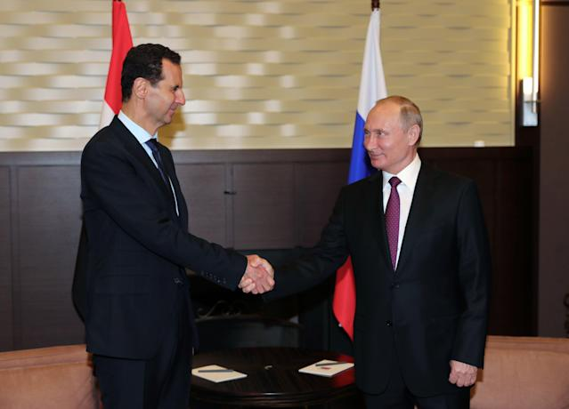 Russian President Vladimir Putin shakes hands with Syrian President Bashar al-Assad during their meeting in the Black Sea resort of Sochi, Russia May 17, 2018. Sputnik/Mikhail Klimentyev/Kremlin via REUTERS ATTENTION EDITORS - THIS IMAGE WAS PROVIDED BY A THIRD PARTY.