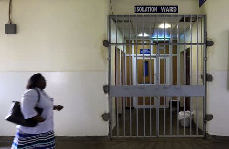 A woman walks past an isolation ward (R) set aside for Ebola related cases at the Kenyatta National Hospital (KNH) in the capital Nairobi August 19, 2014. REUTERS/Noor Khamis