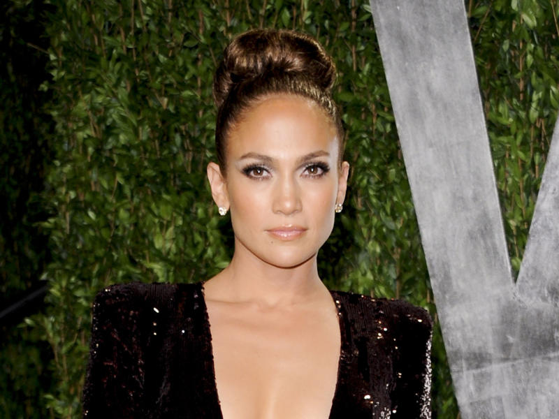 """FILE - In this Feb. 26, 2012 file photo, actress and singer Jennifer Lopez arrives at the Vanity Fair Oscar party in West Hollywood, Calif. Lopez was part of the all-star cast that helped lead """"Ice Age: Continental Drift"""" to the top of the box office over the weekend, and the entertainer is eager to focus even more attention on her once white-hot movie career. She'll certainly have more time now that she's not going to be a judge on """"American Idol."""" She announced last Friday that she will not be coming back to the Fox talent competition, following in the footsteps of fellow judge Steven Tyler, who announced a day earlier that he would leave the show to devote more time to his band, Aerosmith. (AP Photo/Evan Agostini, file)"""