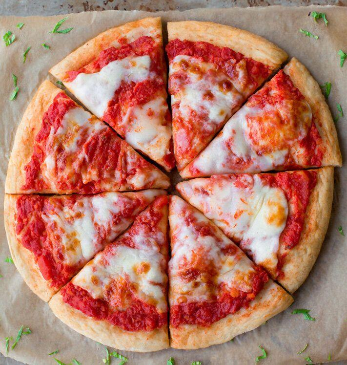 """<a href=""""https://chocolatecoveredkatie.com/vegan-pizza-recipe/"""" target=""""_blank"""" rel=""""noopener noreferrer""""><strong>Get the Vegan Pizza recipe from Chocolate Covered Katie.</strong></a>"""