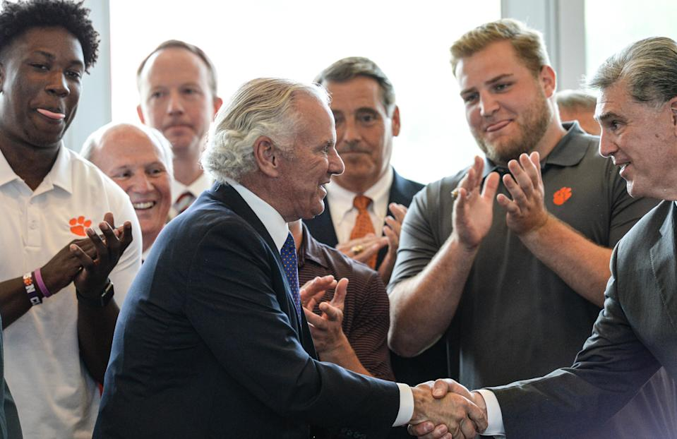 South Carolina Gov. Henry McMaster shakes hands with Athletic Director Dan Radakovic after he signed s. 685, Compensation of Intercollegiate Athletes, a ceremonial bill-signing at Memorial Stadium in Clemson Monday, June 14, 2021.