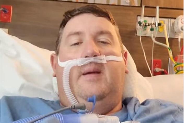 Image: Travis Campbell has been making Facebook videos and posts asking people to get vaccinated against Covid-19 after testing positive and being hospitalized for the virus. (Travis Campbell)