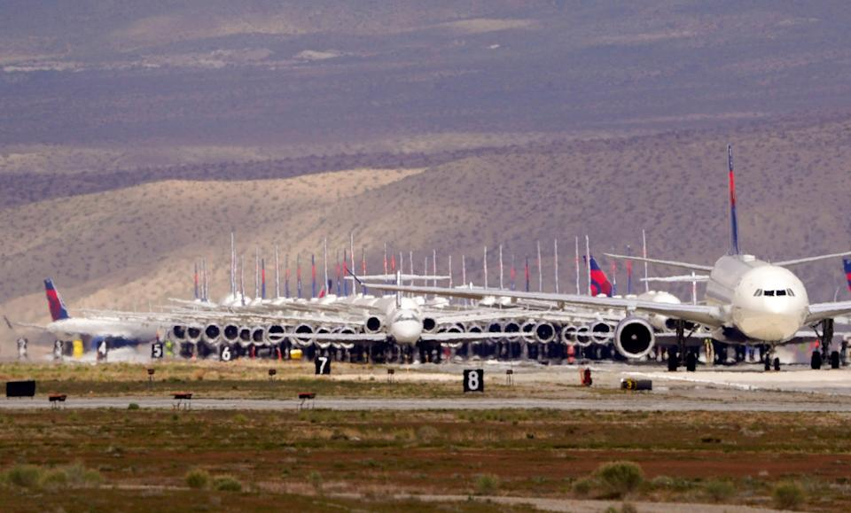 Delta Air Lines aircraft are stored at Southern California Logistics Airport, Wednesday, March 25, 2020, in Victorville, Calif.