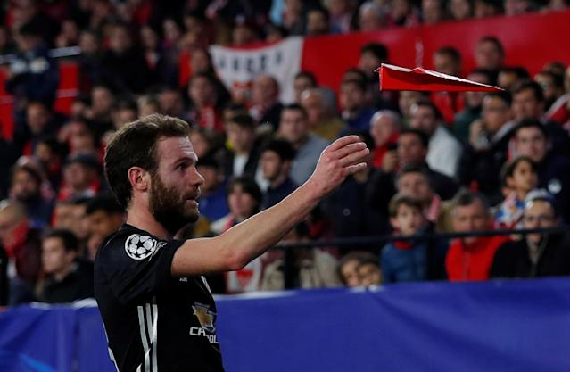 Soccer Football - Champions League Round of 16 First Leg - Sevilla vs Manchester United - Ramon Sanchez Pizjuan, Seville, Spain - February 21, 2018 Manchester United's Juan Mata throws a paper aeroplane during the game Action Images via Reuters/Andrew Couldridge