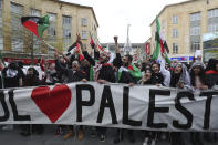 People hold placards and Palestinian flags as they march in solidarity with the Palestinian people amid the ongoing conflict with Israel, during a demonstration in Bristol, England, Saturday, May 15, 2021. (Andrew Matthews/PA via AP)
