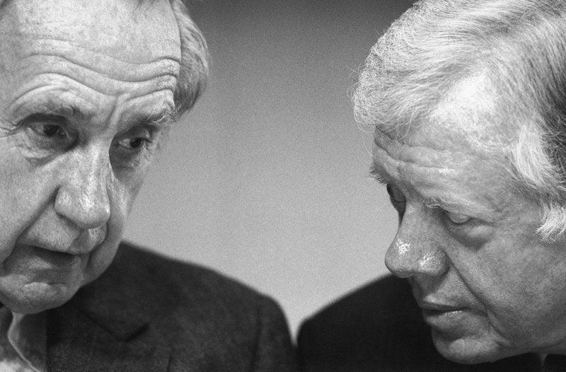 <p>Sir Brian Urquhart, former under secretary-general of the United Nations, left, and former President Jimmy Carter confer during the opening session of a Middle East conference held at the Carter Center in Atlanta, Ga.</p> (AP Photo/Linda Schaefer)