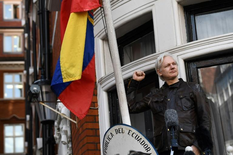 Wikileaks founder Julian Assange raises his fist prior to addressing the media on the balcony of the Embassy of Ecuador in London on May 19, 2017