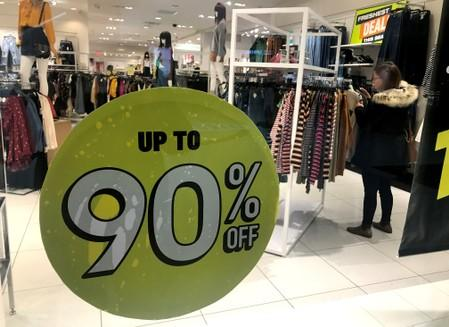 A shopper browses through clothes in a Forever 21 fashion retail store in downtown Toronto