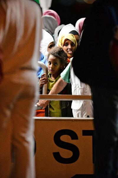 "Migrants wait to disembark from the ""Phoenix"" ship upon their arrival in the port of Augusta on the eastern coast of Sicily on June 7, 2015 (AFP Photo/Giovanni Isolino)"