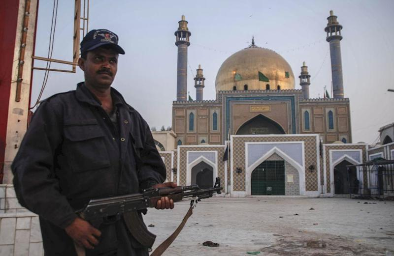 A police officer guards the shrine a day after the explosion.