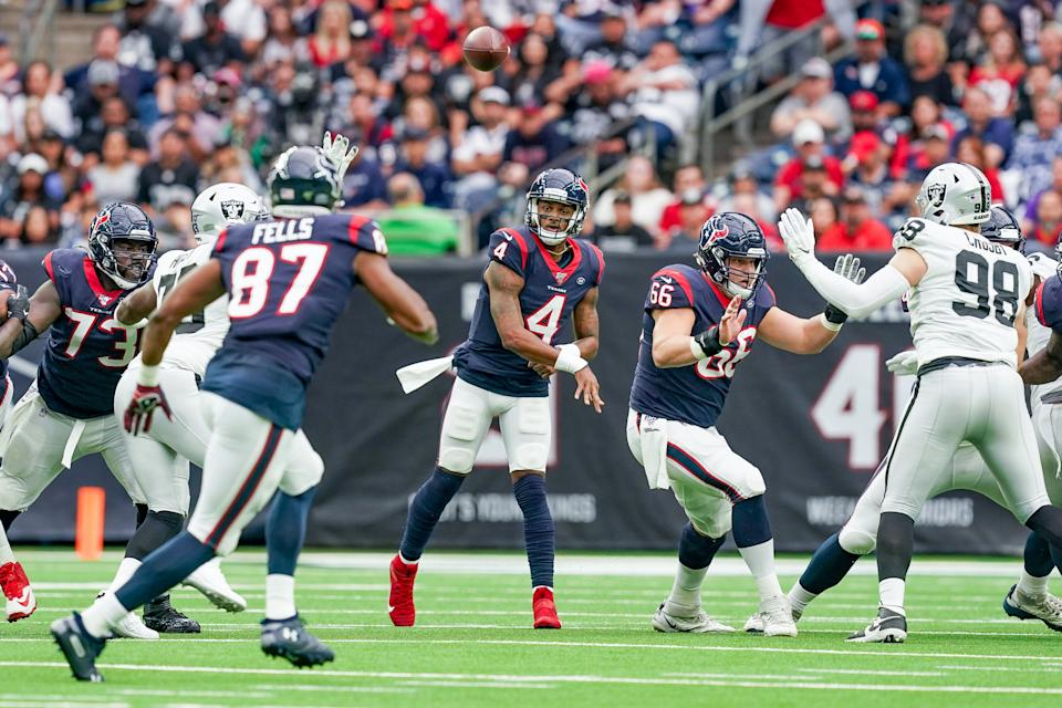 Houston Texans quarterback Deshaun Watson threw a touchdown after getting kicked near the eye. (Getty Images)