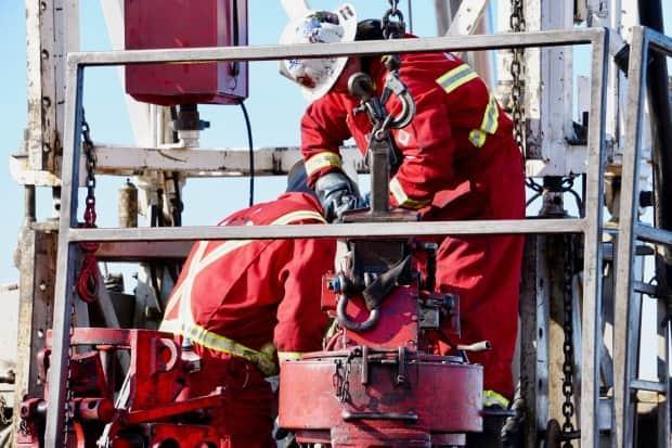Workers perform maintenance on an oil rig in Alberta. The future of the province's energy sector could be determined by the results of the Sept. 20 federal election. (Kyle Bakx/CBC - image credit)