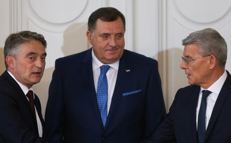 FILE PHOTO: Newly elected members of Bosnia's tripartite inter-ethnic presidency attend the presidential inauguration ceremony in Sarajevo