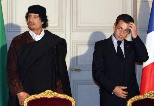 Nicolas Sarkozy (right) and Moamer Kadhafi meet to sign trade deals at the Elysee Palace in Paris on December 10, 2007