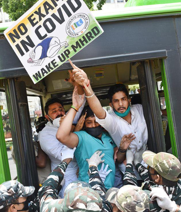 NSUI workers are detained after a protest demanding the cancellation of final year exams and promotion of students on the basis of past performance, ou HRtsideD Ministry at Shastri Bhawan, on July 21, 2020 in New Delhi.