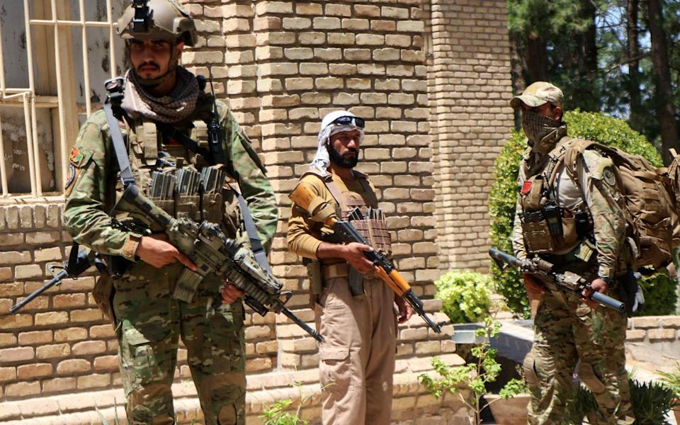 Afghan security officials arrive as part of a reinforcement to fight against Taliban militants - Jalil Rezayee/Shutterstock
