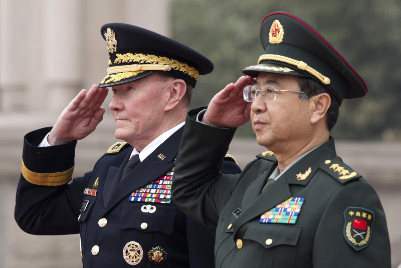 Joint Chiefs Chairman Gen. Martin Dempsey, left, and Chinese counterpart Gen. Fang Fenghui salute during a welcoming ceremony at the Bayi Building in Beijing, China Monday, April 22, 2013. (AP Photo/Andy Wong, Pool)