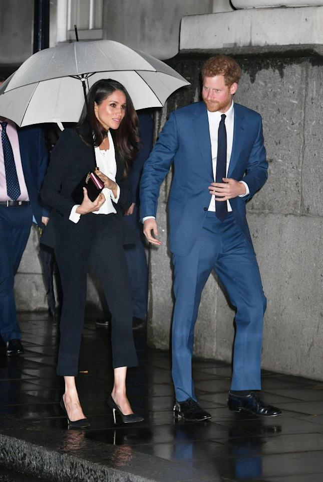 "<p>For her first official evening appearance with Prince Harry, Meghan Markle chose a black pantsuit by Alexander McQueen and paired the look with pointy-toe black pumps.</p><p><a class=""body-btn-link"" href=""https://go.redirectingat.com?id=74968X1596630&url=https%3A%2F%2Fwww.net-a-porter.com%2Fus%2Fen%2Fproduct%2F1071177%2FAlexander_McQueen%2Fgrain-de-poudre-wool-blazer&sref=http%3A%2F%2Fwww.townandcountrymag.com%2Fstyle%2Ffashion-trends%2Fg3272%2Fmeghan-markle-preppy-style%2F"" target=""_blank"">SHOP SIMILAR</a> <em>Alexander McQueen Grain de Poudre Wool Blazer, $1,995</em><br></p>"