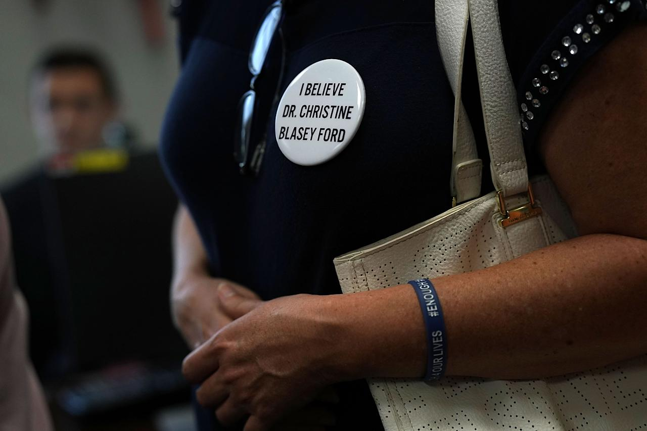 <p>An activists wears a button in support of Christine Blasey Ford, who has accused Supreme Court nominee Judge Brett Kavanaugh of sexual assault at a high school party about 35 years ago, during a protest Sept. 20, 2018 on Capitol Hill in Washington, D.C. (Photo: Alex Wong/Getty Images) </p>