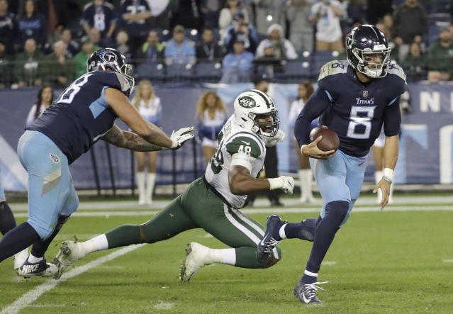 Tennessee Titans quarterback Marcus Mariota (8) gets past New York Jets outside linebacker Jordan Jenkins (48) as Mariota scrambles for a gain of 25 yards in the second half of an NFL football game Sunday, Dec. 2, 2018, in Nashville, Tenn. (AP Photo/James Kenney)
