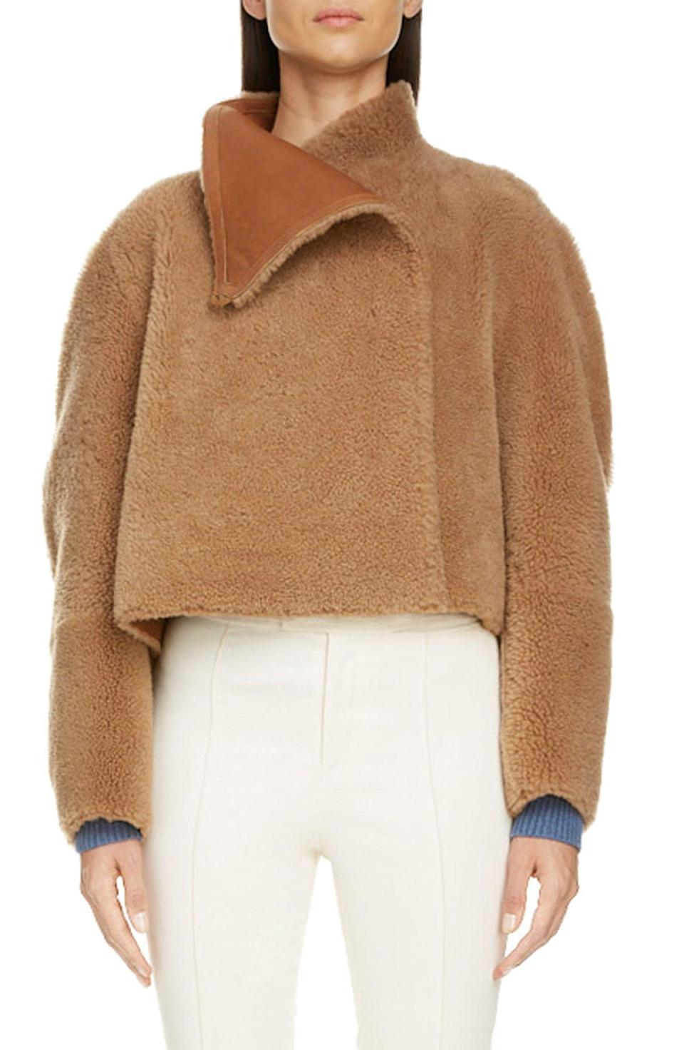 """<p><strong>Isabel Marant</strong></p><p>nordstrom.com</p><p><strong>$2795.00</strong></p><p><a href=""""https://go.redirectingat.com?id=74968X1596630&url=https%3A%2F%2Fwww.nordstrom.com%2Fs%2Fisabel-marant-reversible-genuine-shearling-crop-coat%2F5616478&sref=https%3A%2F%2Fwww.harpersbazaar.com%2Ffashion%2Ftrends%2Fg34113004%2Fbest-teddy-bear-coats%2F"""" rel=""""nofollow noopener"""" target=""""_blank"""" data-ylk=""""slk:Shop Now"""" class=""""link rapid-noclick-resp"""">Shop Now</a></p><p>While the traditional teddy coat isn't cropped, this Isabel Marant gem is a nice alternative to shake things up. </p>"""
