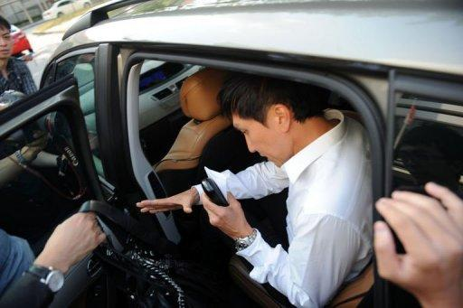 "Pastor Kong Hee (C) leaves court in Singapore on June 27, 2012. Hee, 47, faces three charges of ""criminal breach of trust"" relating to the misuse of the funds of the City Harvest Church, one of Singapore's biggest with a membership of over 30,000"