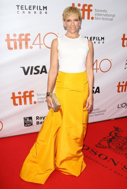 "<p>Toni Collette shined bright at the ""Miss You Already"" premiere during 2015 Toronto International Film Festival in a canary yellow skirt with a a white tank top.</p>"