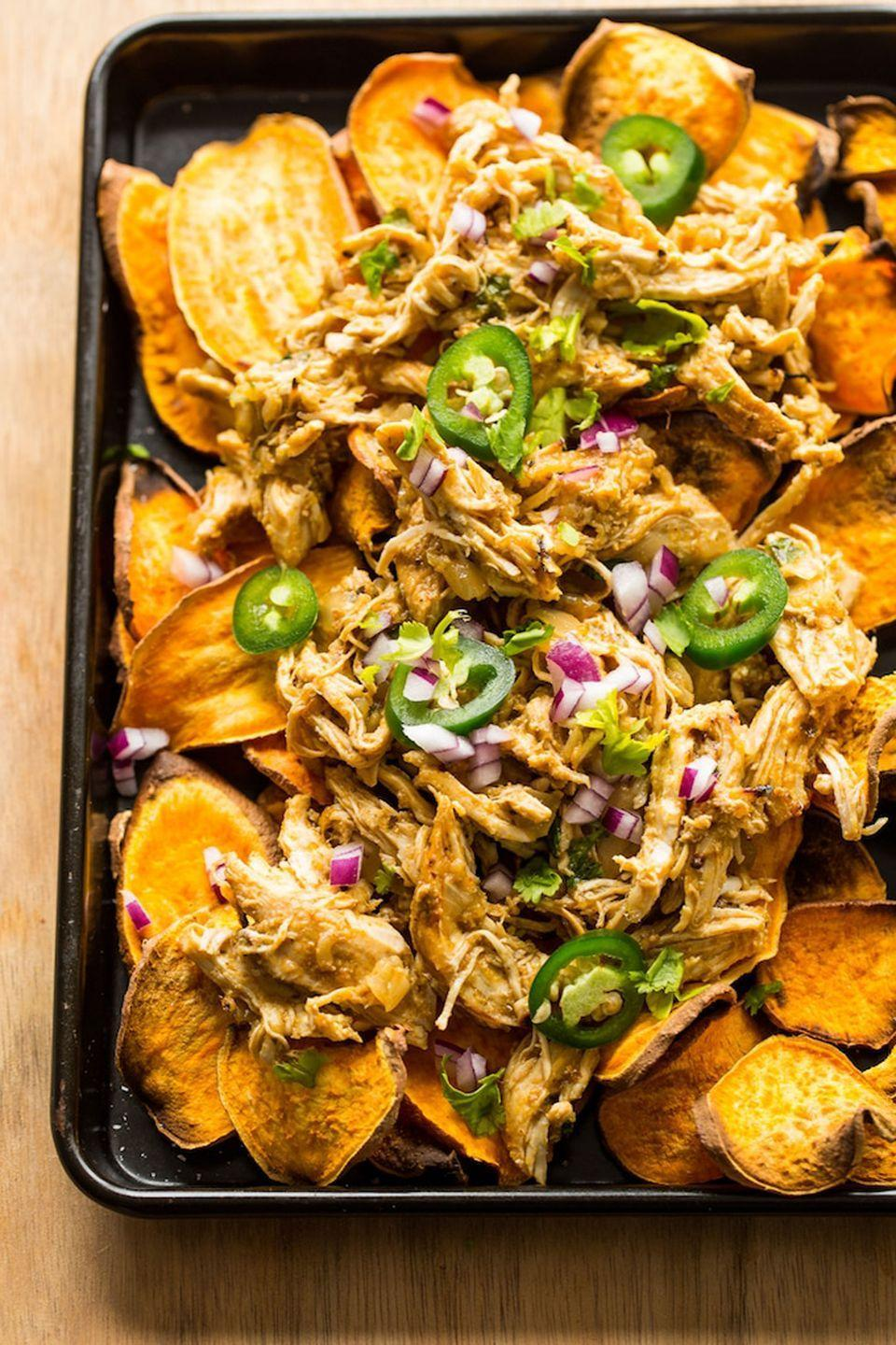 """<p>Swap out tortilla chips for sliced sweet potatoes for a healthy twist on your favorite bar food.</p><p><strong>Get the recipe at <a href=""""https://www.asaucykitchen.com/sweet-potato-nachos-with-chicken-carnitas/"""" rel=""""nofollow noopener"""" target=""""_blank"""" data-ylk=""""slk:A Saucy Kitchen"""" class=""""link rapid-noclick-resp"""">A Saucy Kitchen</a>.</strong></p><p><strong><a class=""""link rapid-noclick-resp"""" href=""""https://www.amazon.com/Nordic-Ware-Natural-Aluminum-Commercial/dp/B0049C2S32/?tag=syn-yahoo-20&ascsubtag=%5Bartid%7C10050.g.877%5Bsrc%7Cyahoo-us"""" rel=""""nofollow noopener"""" target=""""_blank"""" data-ylk=""""slk:SHOP BAKING SHEETS"""">SHOP BAKING SHEETS</a><br></strong></p>"""