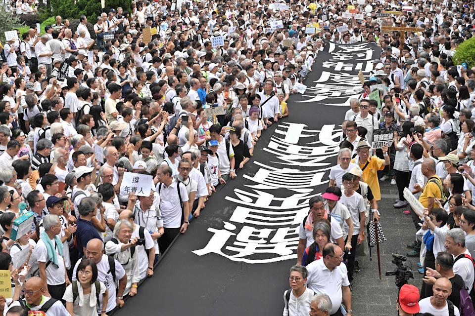 A group of elderly people march to the government headquarters in Hong Kong on July 17, 2019, in the latest protest against a controversial extradition bill. - Hong Kong has been rocked by more than a month of huge largely peaceful protests -- as well as a series of separate violent confrontations with police -- sparked by a law that would have allowed extraditions to mainland China and other countries. (Photo by Anthony WALLACE / AFP)        (Photo credit should read ANTHONY WALLACE/AFP/Getty Images)