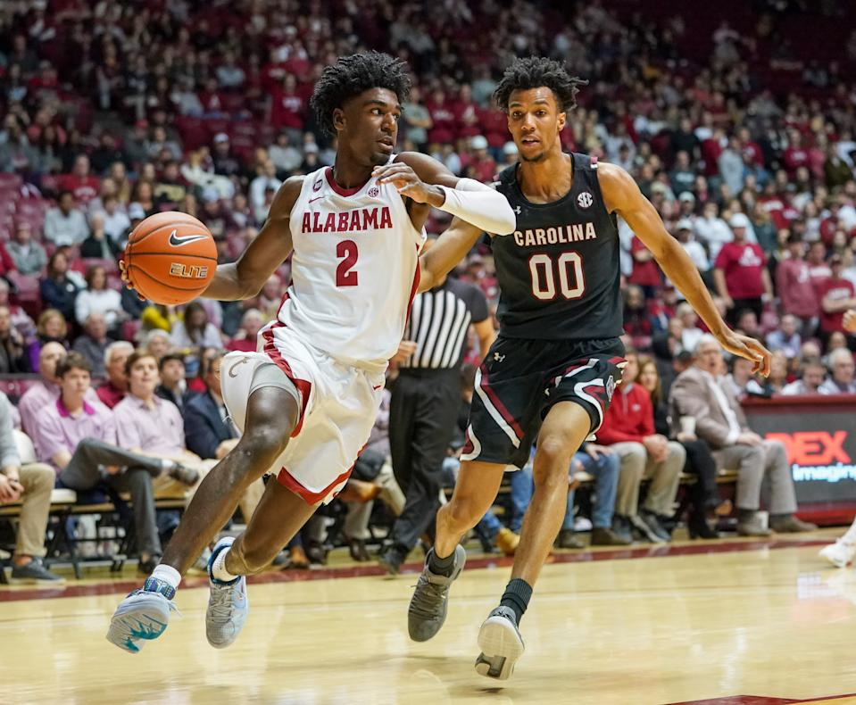 Alabama Crimson Tide guard Kira Lewis Jr. (2) drives to the basket against South Carolina Gamecocks guard A.J. Lawson (00) during a game on Feb. 29, 2020. (Marvin Gentry-USA TODAY Sports)