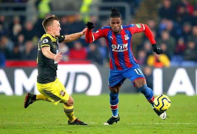 Southampton's James Ward-Prowse, left, and Crystal Palace's Wilfried Zaha battle for the ball (Nigel French/PA)