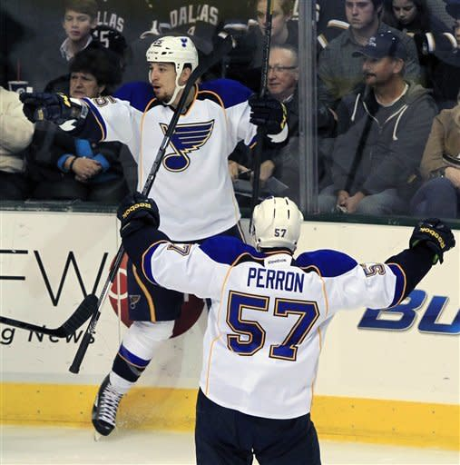 St. Louis Blues right wing Chris Stewart (25) and left wing David Perron (57) celebrate Stewart's goal during the second period of an NHL hockey game on Saturday, Jan. 26, 2013, in Dallas. (AP Photo/John F. Rhodes)