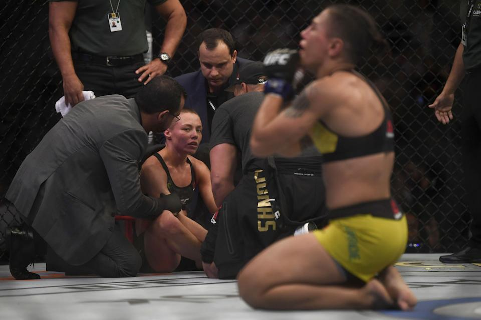 US fighter Rose Namajunas looks at her opponent, Brazilian fighter Jessica Andrade (R), celebrating her victory during their women's strawweight title bout at the Ultimate Fighting Championship 237 event (UFC 237) at Jeunesse Arena in Rio de Janeiro on May 11, 2019. (MAURO PIMENTEL/AFP/Getty Images)