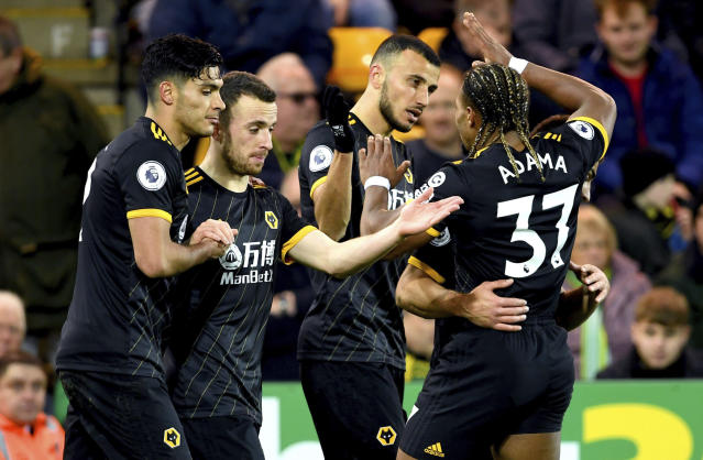 Wolverhampton Wanderers' Romain Saiss, centre, celebrates scoring his side's first goal of the game with his teammates during the English Premier League soccer match between Norwich and Wolverhampton Wanderers, at Carrow Road, in Norwich, England, Saturday Dec. 21, 2019. (Joe Giddens/PA via AP)