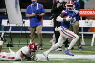 Florida wide receiver Kadarius Toney (1) runs for a touchdown after a catch during the first half of the Southeastern Conference championship NCAA college football game against Alabama, Saturday, Dec. 19, 2020, in Atlanta. (AP Photo/John Bazemore)