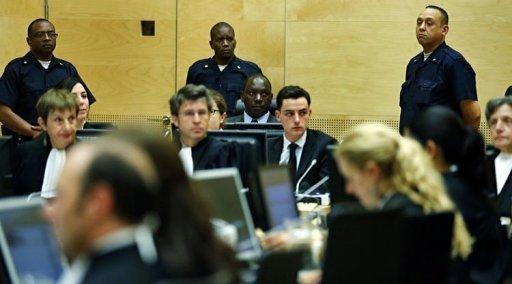 Congolese warlord Thomas Lubanga (C) hears the first-ever sentence delivered by The International Criminal Court (ICC)