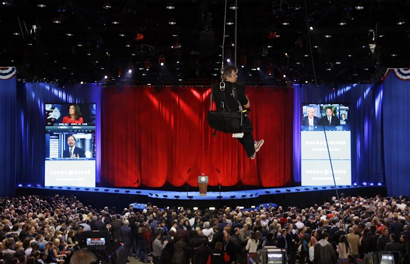 A rigger makes his way up top the rafters during the election night party for President Barack Obama Tuesday, Nov. 6, 2012, in Chicago. (AP Photo/Chris Carlson)