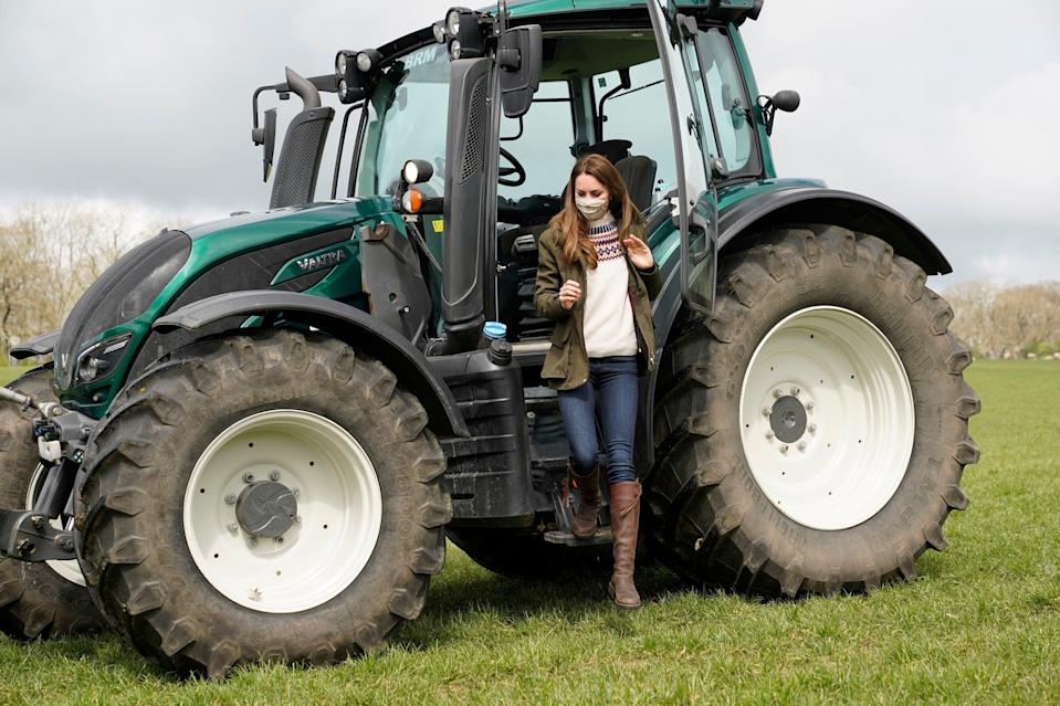 <p>The Duchess of Cambridge steps down from a tractor during her visit with Prince William to Manor Farm in Little Stainton, Durham</p> (AP)