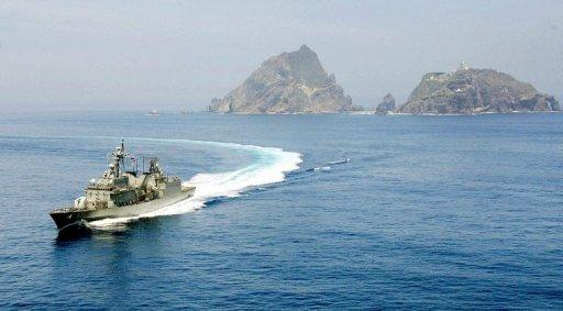 This file handout photo, released by South Korea Navy in 2008, shows a S. Korean destroyer, sailing near a group of islets in the Sea of Japan (East Sea), known as Dokdo in Korean and Takeshima in Japanese, during a sea drill