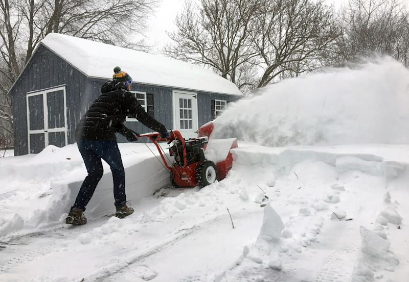 Ben Jennings snowblows his driveway on Sunday, Jan. 20, in Glenville, N.Y., where 16 inches of snow fell from Saturday evening through noon Sunday.