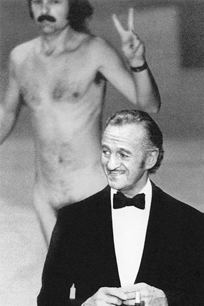 "<b>The streaker (1974): </b> Just as host David Niven was about to introduce Elizabeth Taylor, a naked man came running across the stage behind him, flashing a peace sign. (It was the '70s.) The whole place naturally went wild with laughter, but Niven, being the epitome of British class and cool, didn't miss a beat. He deadpanned: ""Well, ladies and gentlemen, that was almost bound to happen. But isn't it fascinating to think that probably the only laugh that man will ever get in his life is by stripping off and showing his shortcomings?"""