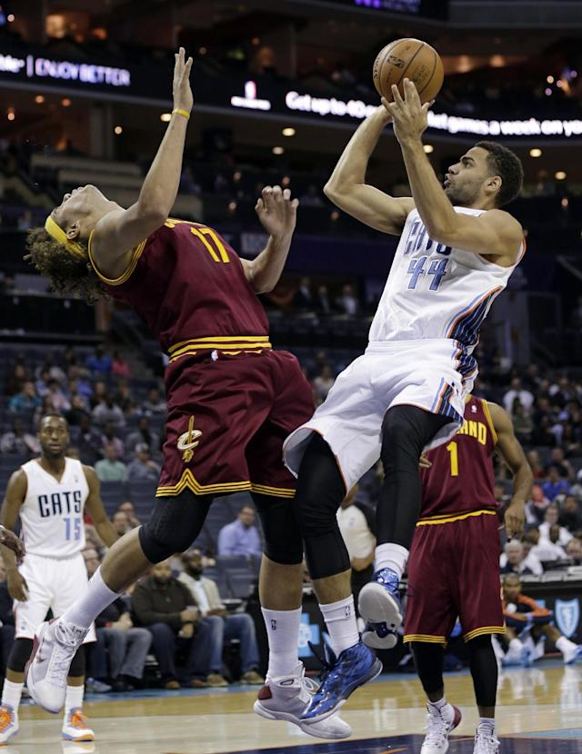 Charlotte Bobcats' Jeffery Taylor (44) shoots over Cleveland Cavaliers' Anderson Varejao in the first half of a preseason NBA basketball game in Charlotte, N.C., Thursday, Oct. 24, 2013. (AP Photo/Chuck Burton)