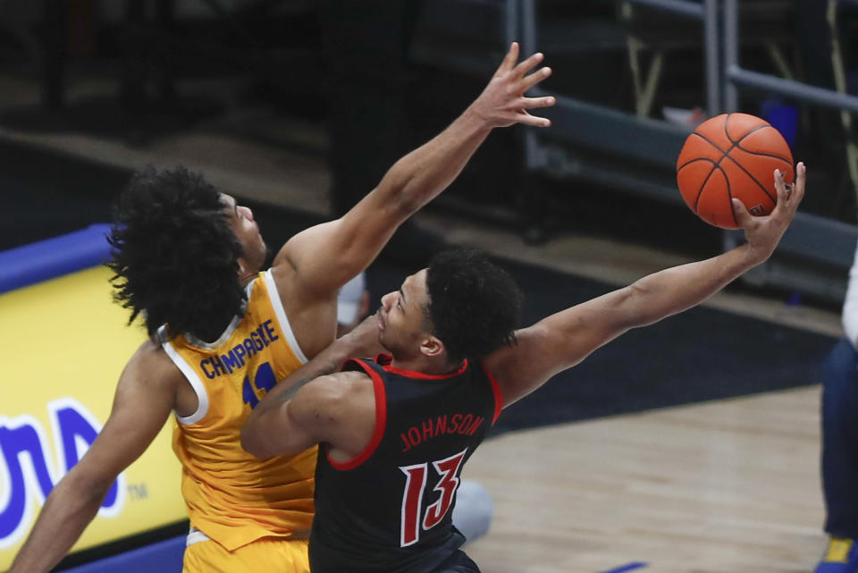 Louisville's David Johnson (13) goes to the basket at Pittsburgh's Justin Champagnie defends during the second half of an NCAA college basketball game Tuesday, Jan. 14, 2020, in Pittsburgh. Johnson missed the dunk. (AP Photo/Keith Srakocic)