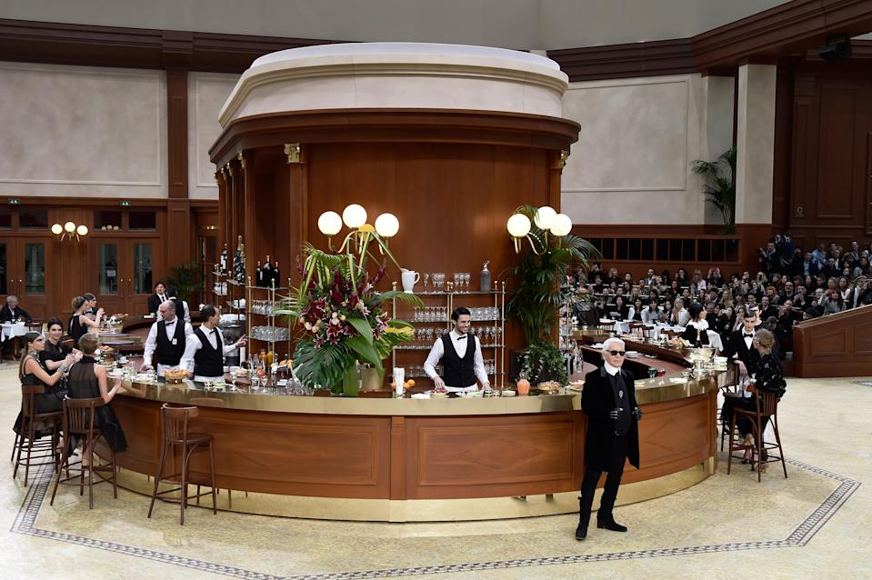 <p>Oozing sophistication, models with slick ponytails clad in Chanel suits sat at the bar to debut the AW15 collection. <em>[Photo: Getty]</em> </p>